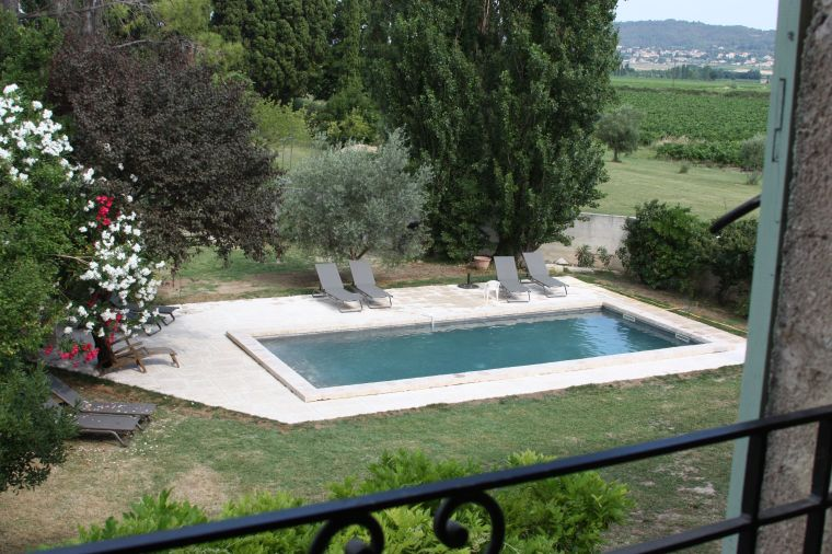 View of pool from a bedroom