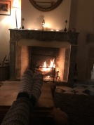 Relaxing toes by the fireplace